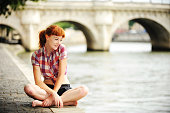 Redhead tourist sitting along the Seine in Paris, France [url=http://www.istockphoto.com/file_search.php?action=file&lightboxID=4229758][img]http://www.erichoodphoto.com/istock/lifestyles.jpg[/img][/u