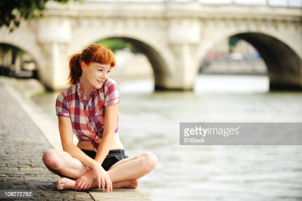 Redheaded Tourist Along Seine River Paris France
