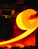 Red-hot roll of steel in steel mill