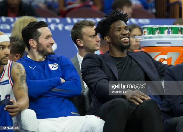 Redick and Joel Embiid of the Philadelphia 76ers share a laugh on the bench in the third quarter of the preseason game against the Memphis Grizzlies...