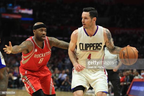 Redick of the LA Clippers dribbles past Bobby Brown of the Houston Rockets during the second half of a game at Staples Center on April 10 2017 in Los...