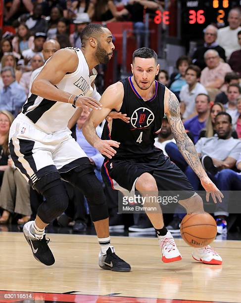 J Redick of the LA Clippers drives on Wayne Ellington of the Miami Heat during a game at American Airlines Arena on December 16 2016 in Miami Florida...