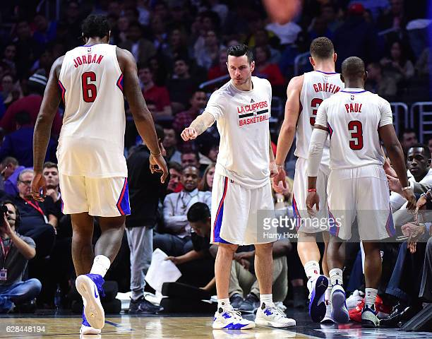 J Redick of the LA Clippers greets Blake Griffin Chris Paul and DeAndre Jordan as they leave the game during a 11598 Golden State Warriors win at...