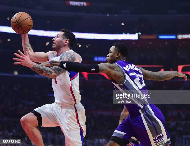 Redick of the LA Clippers is fouled by Ben McLemore of the Sacramento Kings as he drives to the basket during the first half at Staples Center on...