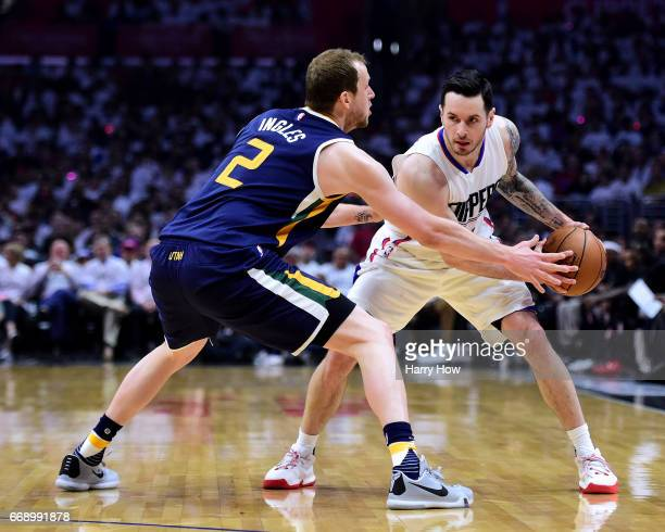 Redick of the LA Clippers is guarded by Joe Ingles of the Utah Jazz during a 9795 Jazz win during the first half at Staples Center on April 15 2017...