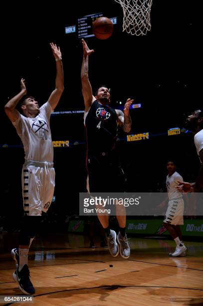 J Redick of the LA Clippers shoots the ball against Juancho Hernangomez of the Denver Nuggets during the game on March 16 2017 at the Pepsi Center in...