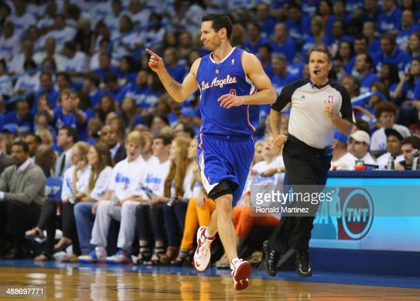 J Redick of the Los Angeles Clippers celebrates a threepoint shot against the Oklahoma City Thunder in Game Two of the Western Conference Semifinals...