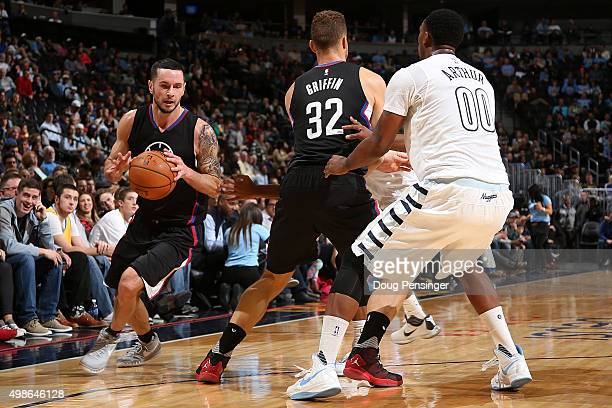 J Redick of the Los Angeles Clippers controls the ball as Blake Griffin of the Los Angeles Clippers screens Darrell Arthur of the Denver Nuggets at...