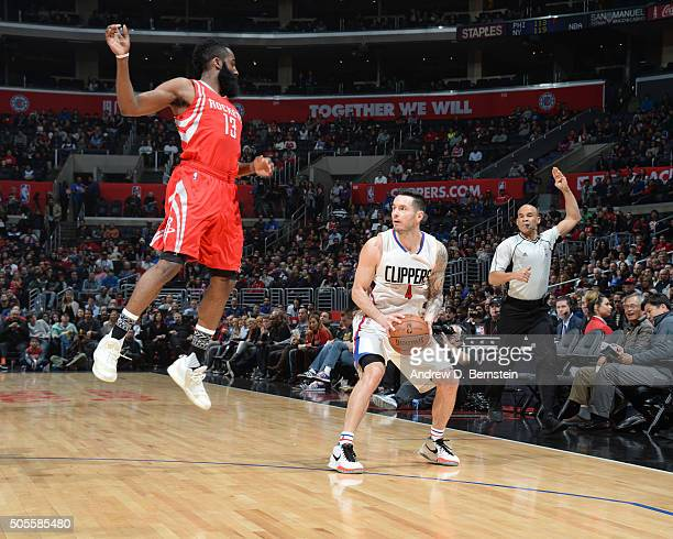 J Redick of the Los Angeles Clippers defends the ball against James Harden of the Houston Rockets during the game on January 18 2016 at STAPLES...