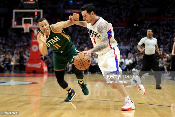 Redick of the Los Angeles Clippers dribbles past Dante Exum of the Utah Jazz during the first half of Game Seven of the Western Conference...