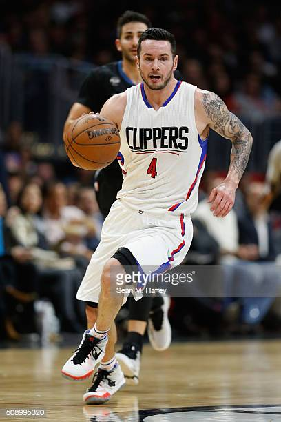 J Redick of the Los Angeles Clippers dribbles upcourt during the second half of a game against the Minnesota Timberwolves at Staples Center on...