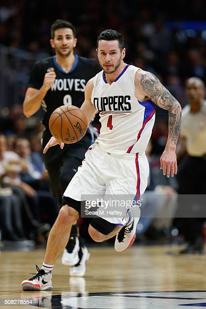 J Redick of the Los Angeles Clippers dribbles upcourt past Ricky Rubio of the Minnesota Timberwolves during the second half of a game at Staples...