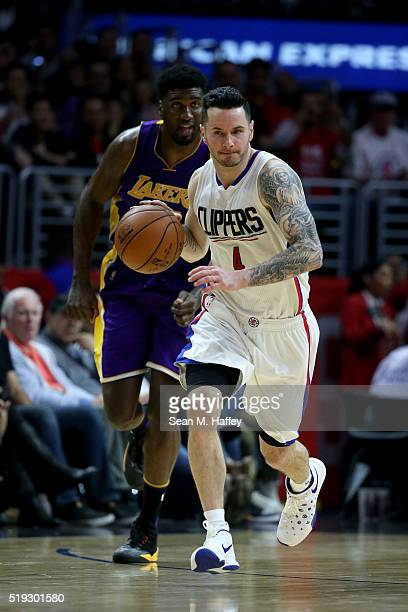 J Redick of the Los Angeles Clippers dribbles upcourt past Roy Hibbert of the Los Angeles Lakers during the second half of an NBA game against the...