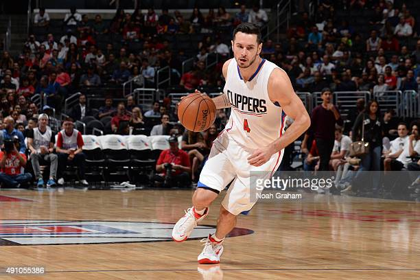 J Redick of the Los Angeles Clippers drives to the basket against the Denver Nuggets during a preseason game on October 2 2015 at STAPLES Center in...