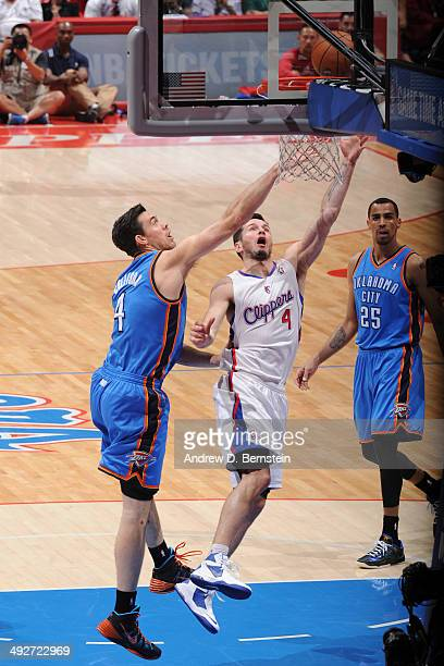 J Redick of the Los Angeles Clippers drives to the basket against the Oklahoma City Thunder in Game Six of the Western Conference Semifinals during...