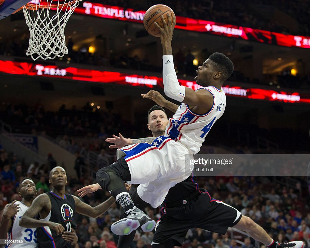J.J Redick #4 of the Los Angeles Clippers fouls <a gi-track='captionPersonalityLinkClicked' href=/galleries/search?phrase=Nerlens+Noel&family=editorial&specificpeople=7880842 ng-click='$event.stopPropagation()'>Nerlens Noel</a> #4 of the Philadelphia 76ers on February 8, 2016 at the Wells Fargo Center in Philadelphia, Pennsylvania.