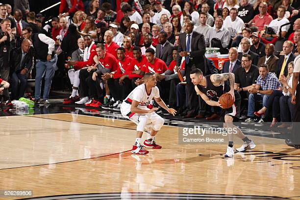 J Redick of the Los Angeles Clippers handles the ball against CJ McCollum of the Portland Trail Blazers in Game Six of the Western Conference...