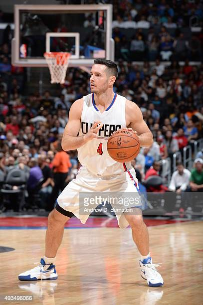J Redick of the Los Angeles Clippers handles the ball against the Golden State Warriors on October 20 2015 at STAPLES Center in Los Angeles...