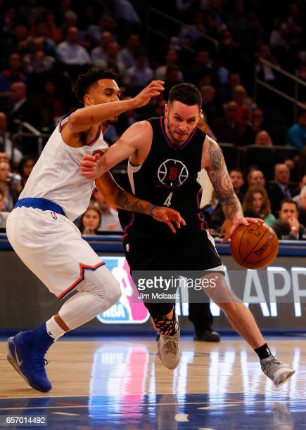 JJ Redick of the Los Angeles Clippers in action against Courtney Lee of the New York Knicks at Madison Square Garden on February 8 2017 in New York...