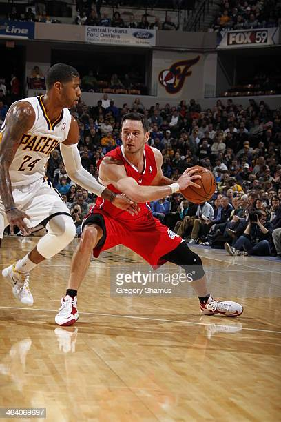 J Redick of the Los Angeles Clippers looks to pass the ball against the Indiana Pacers at Bankers Life Fieldhouse on January 18 2014 in Indianapolis...