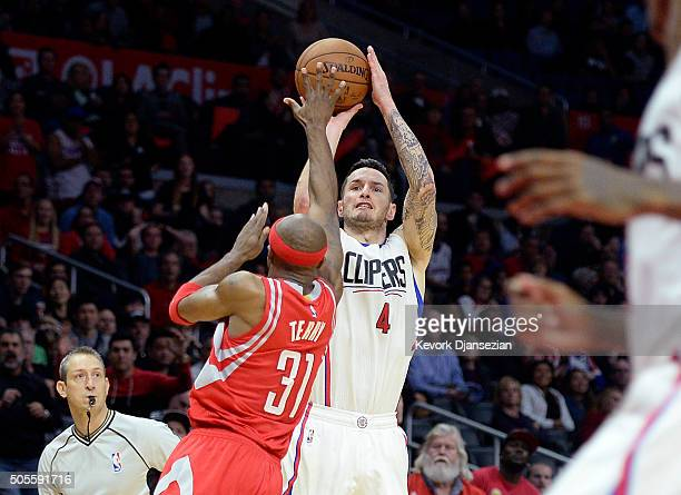 J Redick of the Los Angeles Clippers score on a threepoint basket over Jason Terry of the Houston Rockets in overtime at Staples Center January 18 in...