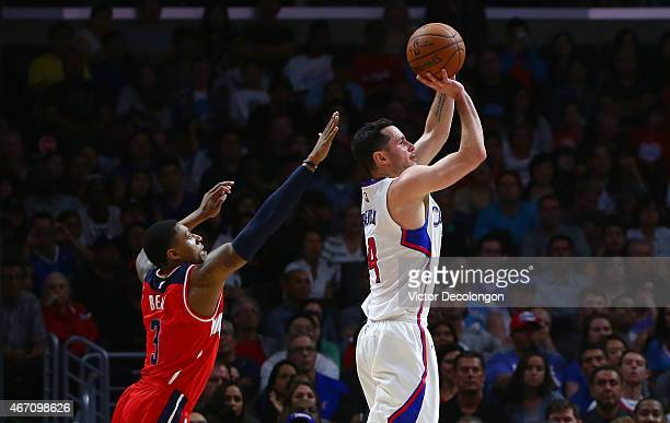 J Redick of the Los Angeles Clippers shoots a jump shot as Bradley Beal of the Washington Wizards tries to defend from behind in the first half...