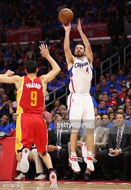 Redick of the Los Angeles Clippers shoots over Pablo Prigioni of the Houston Rockets during Game Three of the Western Conference semifinals of the...
