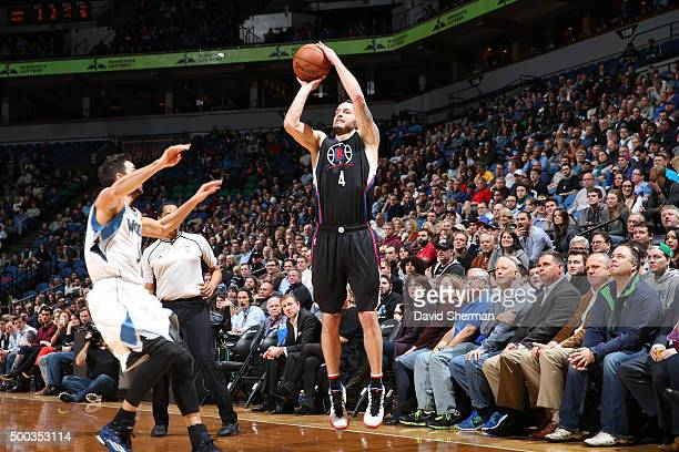 J Redick of the Los Angeles Clippers shoots the ball against the Minnesota Timberwolves on December 7 2015 at Target Center in Minneapolis Minnesota...