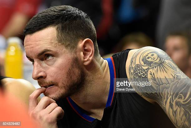 J Redick of the Los Angeles Clippers sits on the bench as time winds down in the fourth quarter of Game Four of the Western Conference Quarterfinals...