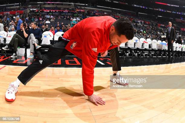 J Redick of the Los Angeles Clippers stretches before the game against the Washington Wizards on March 29 2017 at STAPLES Center in Los Angeles...