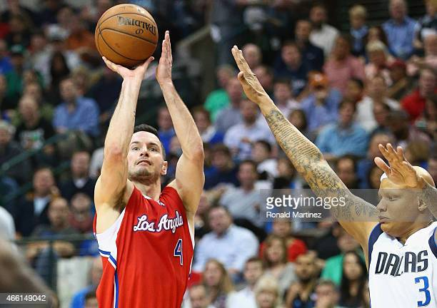 J Redick of the Los Angeles Clippers takes a shot against Charlie Villanueva of the Dallas Mavericks at American Airlines Center on March 13 2015 in...