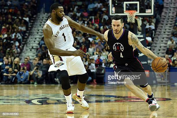 J Redick of the Los Angeles Clippers works against Tyreke Evans of the New Orleans Pelicans during a game at the Smoothie King Center on December 31...