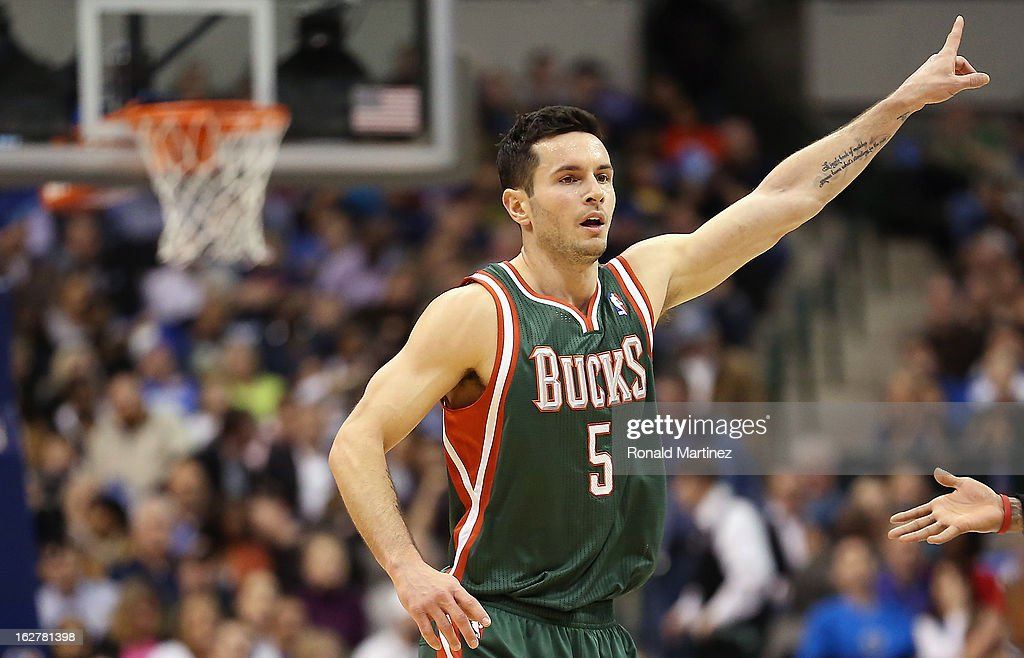 J.J. Redick #5 of the Milwaukee Bucks reacts during play against the Dallas Mavericks at American Airlines Center on February 26, 2013 in Dallas, Texas.
