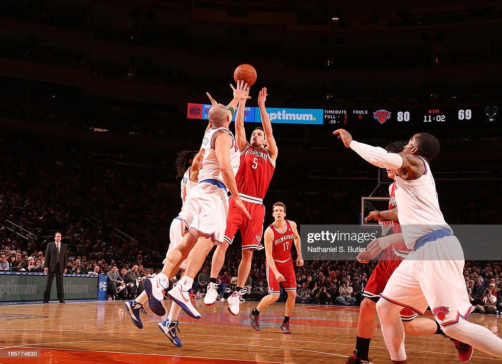 J.J. Redick #5 of the Milwaukee Bucks shoots against Jason Kidd #5 of the New York Knicks on April 5, 2013 at Madison Square Garden in New York City.