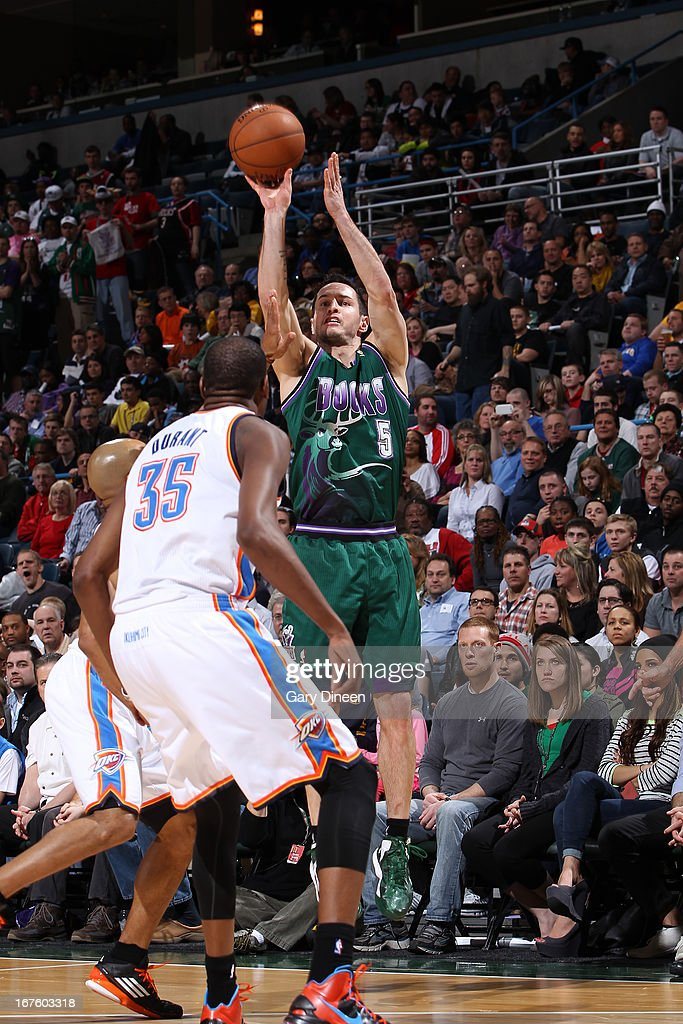 J.J. Redick #5 of the Milwaukee Bucks shoots against the Oklahoma City Thunder on March 30, 2013 at the BMO Harris Bradley Center in Milwaukee, Wisconsin.