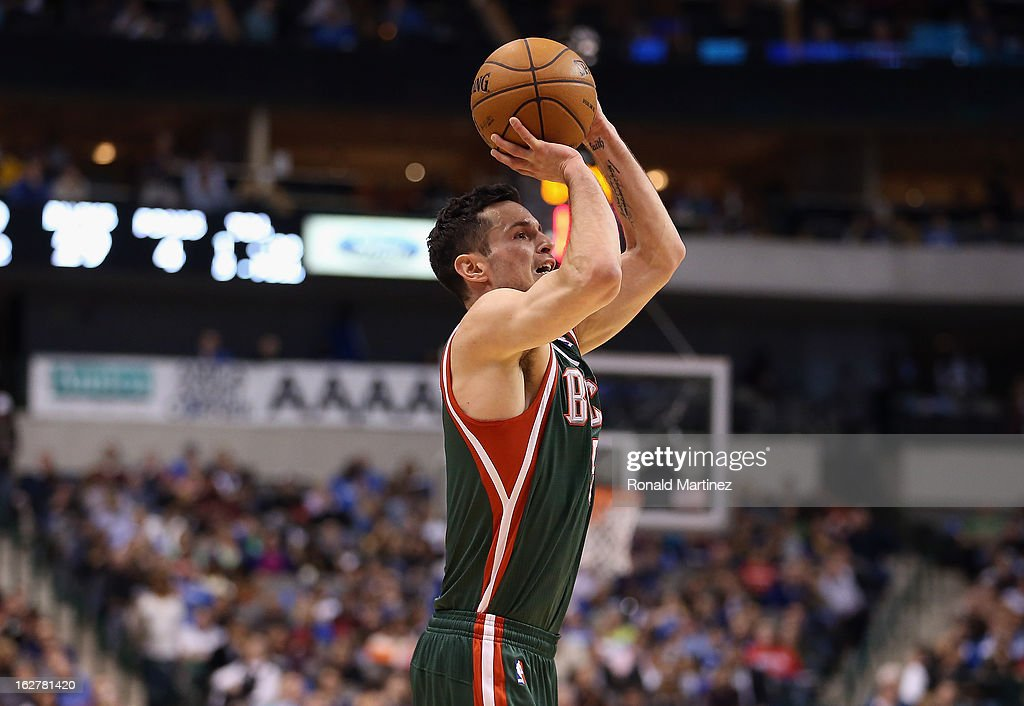 J.J. Redick #5 of the Milwaukee Bucks takes a shot against the Dallas Mavericks at American Airlines Center on February 26, 2013 in Dallas, Texas.