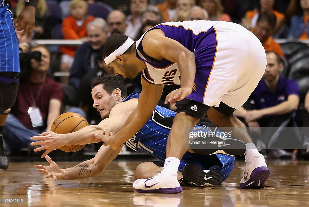 J.J. Redick #7 of the Orlando Magic and Jared Dudley #3 of the Phoenix Suns battle for a loose ball during the NBA game at US Airways Center on December 9, 2012 in Phoenix, Arizona. The Magic defeated the Suns 98-90.