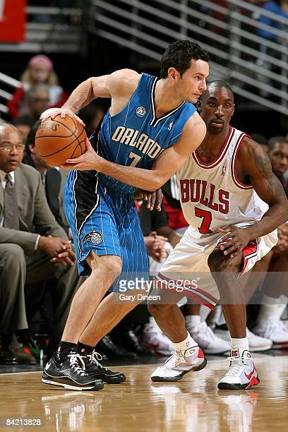 J Redick of the Orlando Magic drives the ball against Ben Gordon of the Chicago Bulls during the game at the United Center on December 31 2008 in...