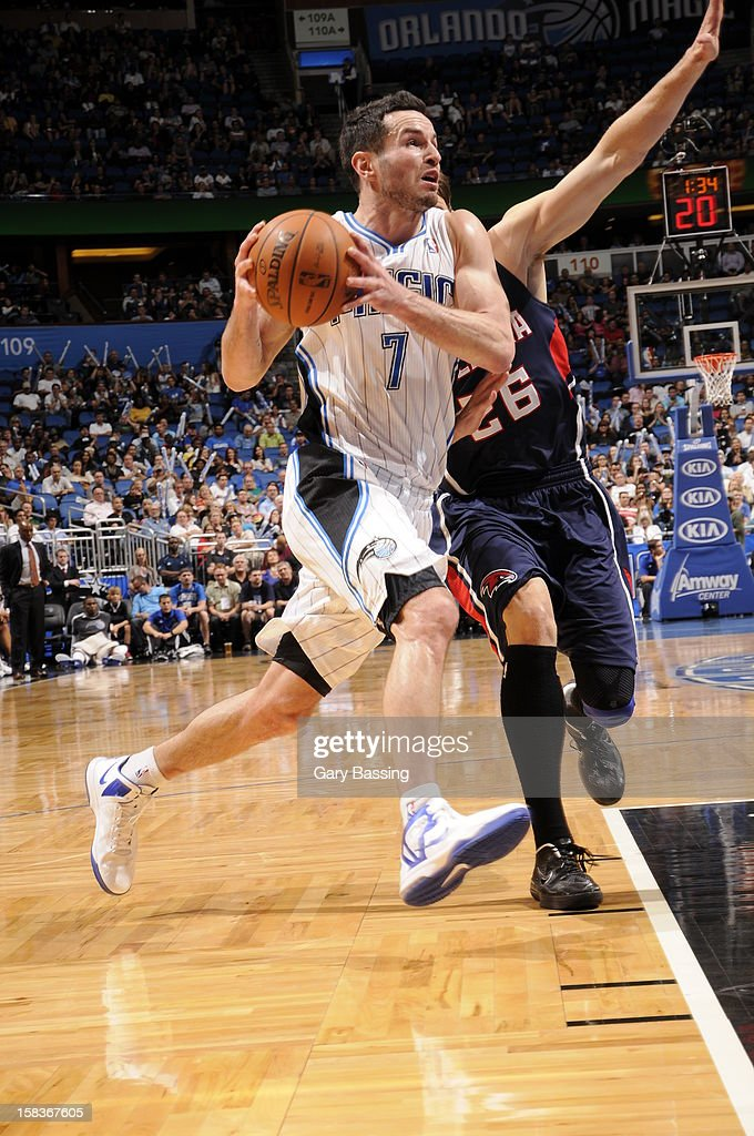 J.J. Redick #7 of the Orlando Magic drives to the basket against the Atlanta Hawks on December 12, 2012 at Amway Center in Orlando, Florida.