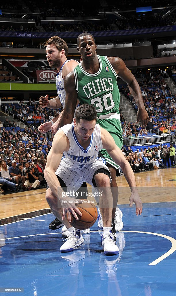 J.J. Redick #7 of the Orlando Magic duves for the loose ball during the game between the Boston Celtics and the Orlando Magic on November 25, 2012 at Amway Center in Orlando, Florida.