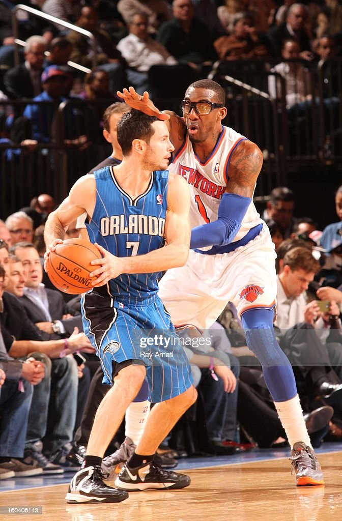 J.J. Redick #7 of the Orlando Magic is defended by Amar'e Stoudemire #1 of the New York Knicks on January 30, 2013 at Madison Square Garden in New York City, New York.