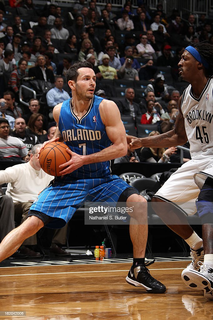 J.J. Redick #7 of the Orlando Magic looks to pass the ball against the Brooklyn Nets on January 28, 2013 at the Barclays Center in the Brooklyn borough of New York City.
