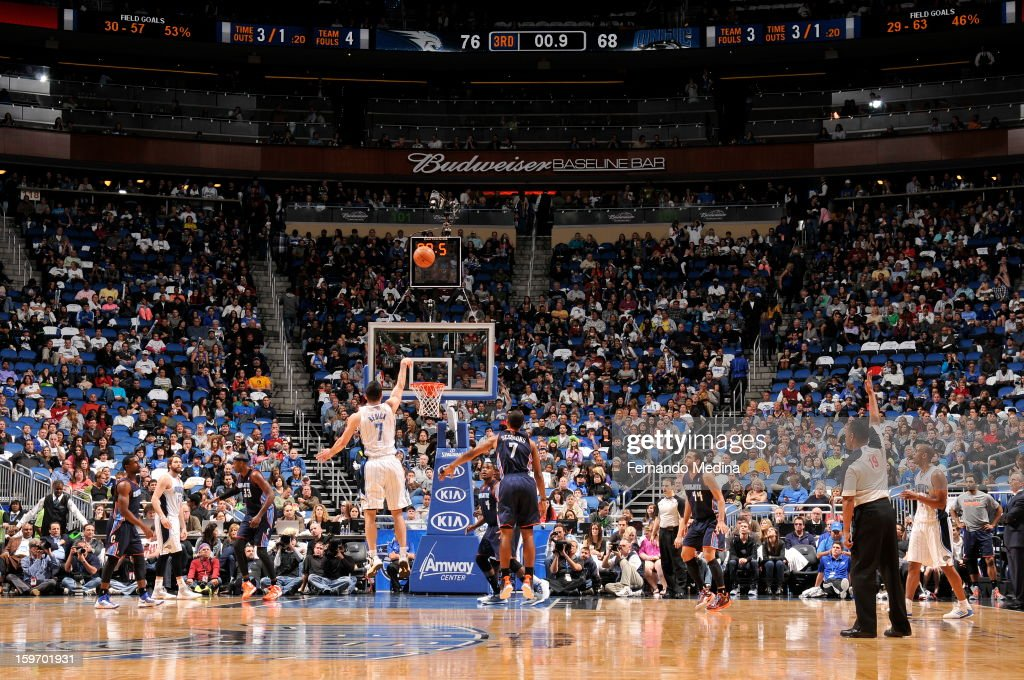 J.J. Redick #7 of the Orlando Magic makes his shot at the buzzer at the end of the 3rd quarter against Ramon Sessions #7 of the Charlotte Bobcats on January 18, 2013 at Amway Center in Orlando, Florida.