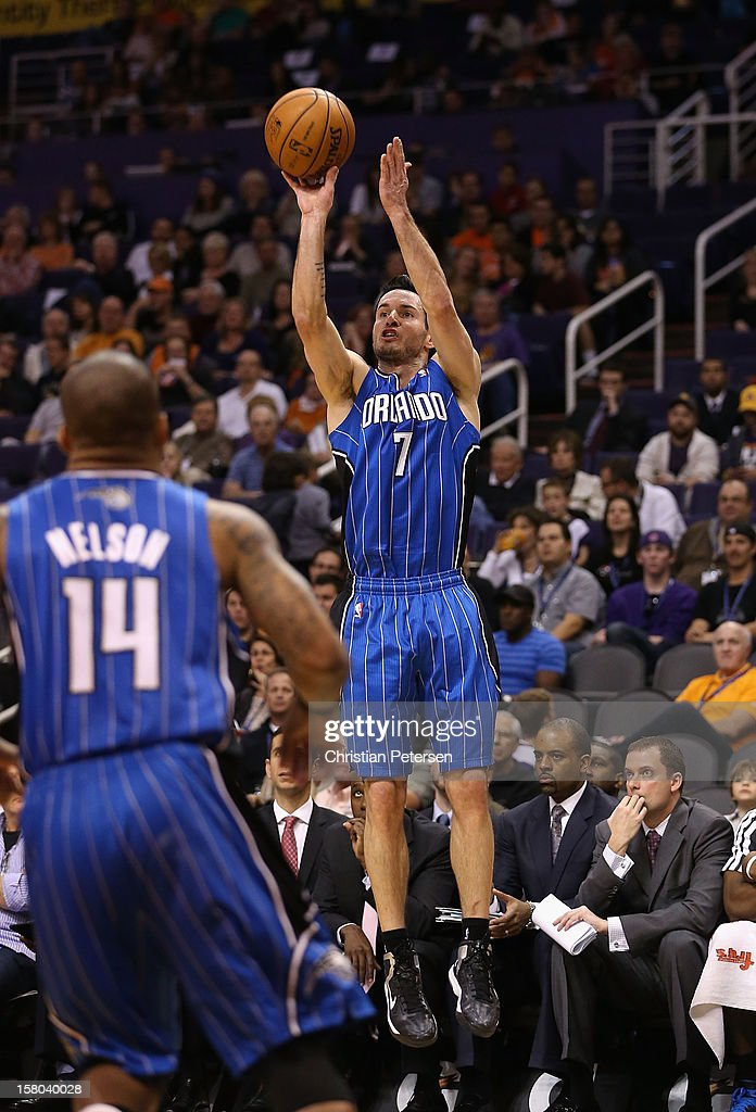 J.J. Redick #7 of the Orlando Magic puts up a three point shot against the Phoenix Suns during the NBA game at US Airways Center on December 9, 2012 in Phoenix, Arizona.