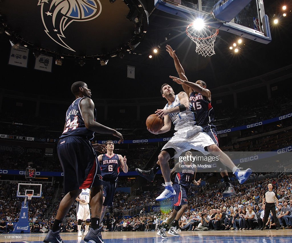 <a gi-track='captionPersonalityLinkClicked' href=/galleries/search?phrase=J.J.+Redick&family=editorial&specificpeople=211608 ng-click='$event.stopPropagation()'>J.J. Redick</a> #7 of the Orlando Magic shoots against <a gi-track='captionPersonalityLinkClicked' href=/galleries/search?phrase=Al+Horford&family=editorial&specificpeople=699030 ng-click='$event.stopPropagation()'>Al Horford</a> #15 of the Atlanta Hawks in Game Five of the Eastern Conference Quarterfinals in the 2011 NBA Playoffs on April 26, 2011 at the Amway Center in Orlando, Florida.