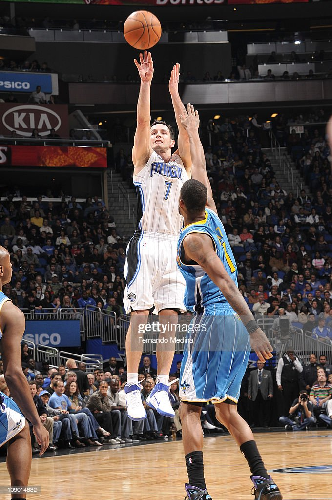 <a gi-track='captionPersonalityLinkClicked' href=/galleries/search?phrase=J.J.+Redick&family=editorial&specificpeople=211608 ng-click='$event.stopPropagation()'>J.J. Redick</a> #7 of the Orlando Magic shoots against <a gi-track='captionPersonalityLinkClicked' href=/galleries/search?phrase=Trevor+Ariza&family=editorial&specificpeople=201708 ng-click='$event.stopPropagation()'>Trevor Ariza</a> #1 of the New Orleans Hornets during the game on February 11, 2011 at the Amway Center in Orlando, Florida.