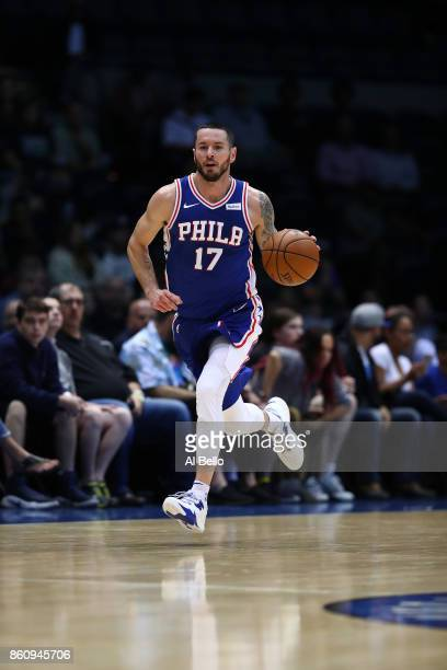 Redick of the Philadelphia 76ers brings the ball upcourt against the Brooklyn Nets during their Pre Season game at Nassau Veterans Memorial Coliseum...