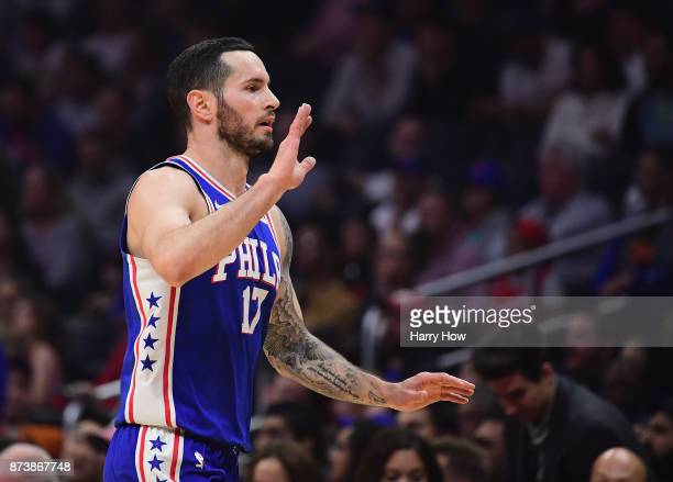 Redick of the Philadelphia 76ers celebrates a play during the first half against the LA Clippers at Staples Center on November 13 2017 in Los Angeles...