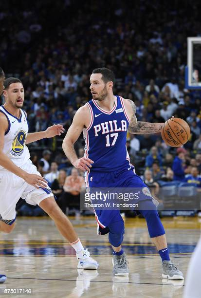 Redick of the Philadelphia 76ers dribbles the ball past Klay Thompson of the Golden State Warriors during an NBA basketball game at ORACLE Arena on...