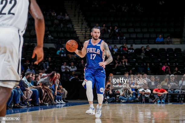 Redick of the Philadelphia 76ers handles the ball during the preseason game against the Brooklyn Nets on October 11 2017 at Nassau Veterans Memorial...